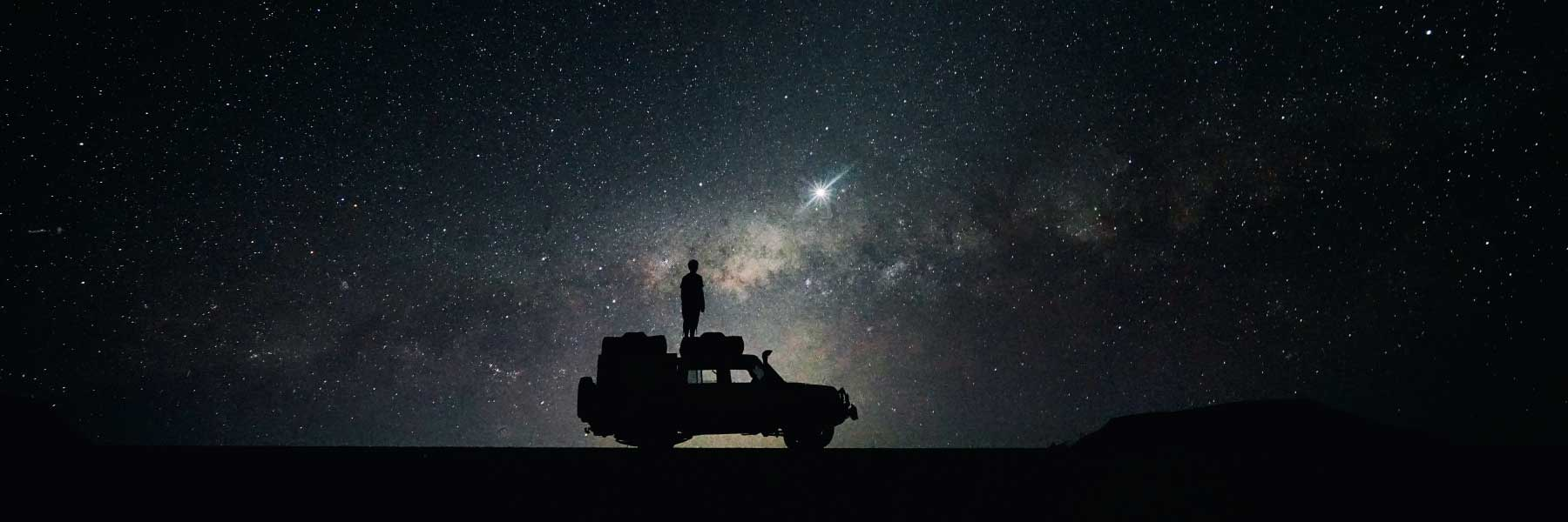 Man Standing on Car - Night Photography